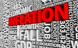 Wall of white letters forming words that have to do with the economy, with the word inflation shown in red letters.